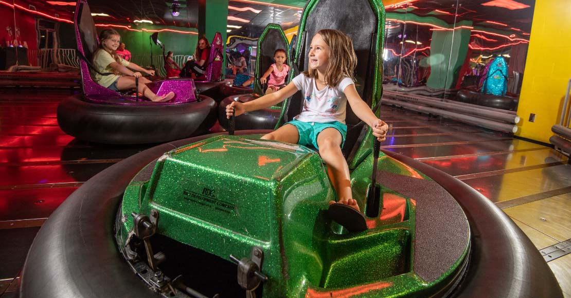 kid driving a bumper car